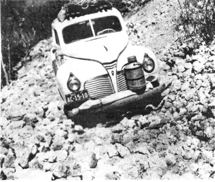 PanAm car crawling over rocks.