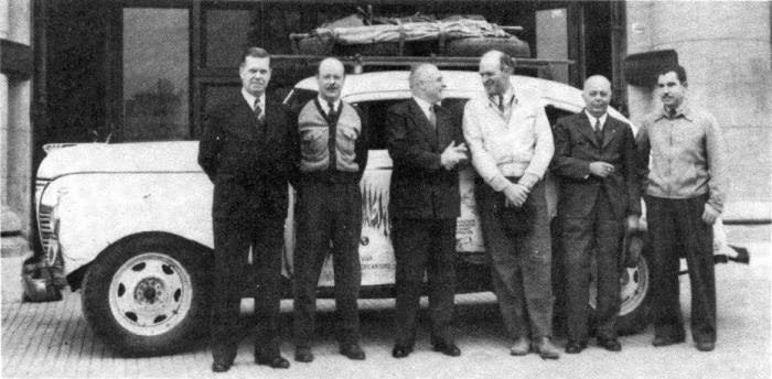 Fevre and Basset greet the expedition in front of their Buenos Aries facilities.